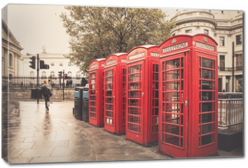 Obraz na płótnie canvas - Vintage style  red telephone booths on rainy street in London