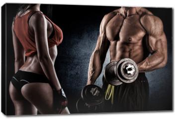 Obraz na płótnie canvas - Closeup of a muscular young man lifting weights