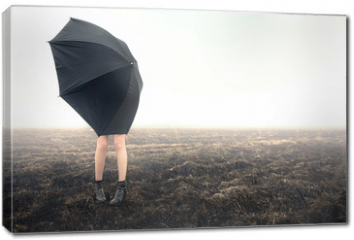 Obraz na płótnie canvas -  girl with umbrella on black field