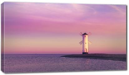 Obraz na płótnie canvas - Purple sunrise over Baltic Sea coast.