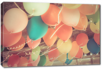 Obraz na płótnie canvas - Colorful balloons floating on the ceiling of a party in vintage