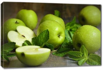 Obraz na płótnie canvas - Green apples with mint leaves.