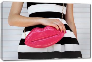 Obraz na płótnie canvas - trendy girl in elegant striped dress with pink leather clutch