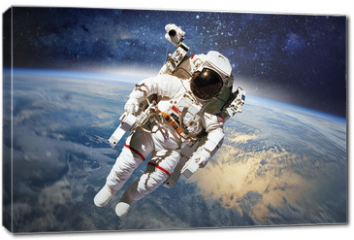 Obraz na płótnie canvas - Astronaut in outer space with planet earth as backdrop. Elements