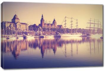 Obraz na płótnie canvas - Vintage style sailing ships at sunrise in Szczecin.