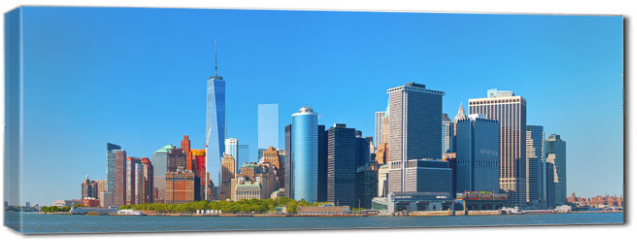 Obraz na płótnie canvas - New York City lower Manhattan financial  wall street district buildings skyline on a beautiful summer day with blue sky