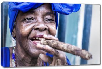 Obraz na płótnie canvas - Portrait of african cuban woman smoking cigar in Havana, Cuba
