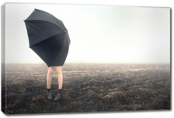Obraz na płótnie canvas - Dziewczyna z parasolką na polu