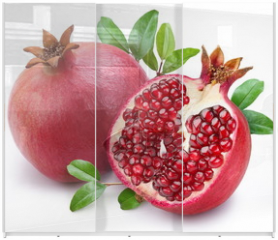 Panel szklany do szafy przesuwnej - Juicy pomegranate and its half with leaves.