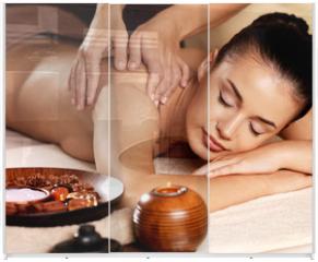 Panel szklany do szafy przesuwnej - Woman having massage in the spa salon