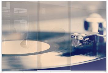 Panel szklany do szafy przesuwnej - Spinning vinyl record. Motion blur image.  Vintage toned.