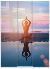 Panel szklany do szafy przesuwnej - Silhouette of a woman yoga on sea sunset with reflection.