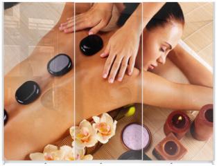 Panel szklany do szafy przesuwnej - Adult woman having hot stone massage in spa salon