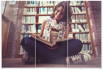 Panel szklany do szafy przesuwnej - Happy female student against bookshelf reading a book on the lib