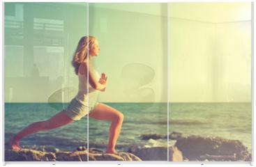 Panel szklany do szafy przesuwnej - young woman doing yoga on  beach