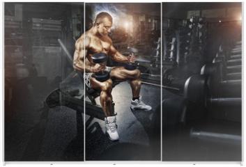 Panel szklany do szafy przesuwnej - Athlete in the gym training with dumbbells