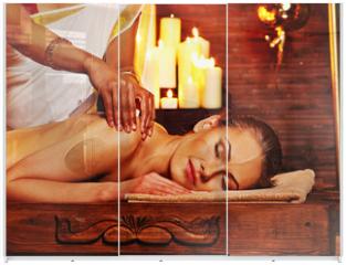 Panel szklany do szafy przesuwnej - Woman having Ayurvedic spa treatment.