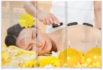 Panel szklany do szafy przesuwnej - Woman Receiving Hot Stone Therapy In Spa