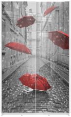 Panel szklany do szafy przesuwnej - Red umbrellas flying on the street. Conceptual image