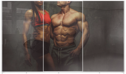 Panel szklany do szafy przesuwnej - Woman and man bodybuilders posing in studio