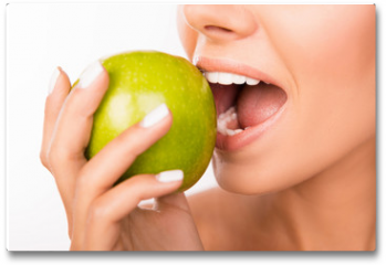 Plakat - Closeup photo of a beautiful healthy girl biting an apple
