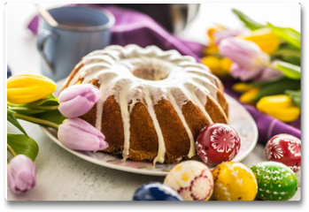 Plakat - Easter Cake. Traditional ring marble cake withe easter decotation. Easter eggs and spring tulips.