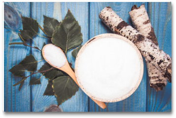 Plakat - Xylitol - sugar substitute. Birch sugar on blue wooden background.