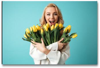 Plakat - Portrait of a joyful young blonde woman in sweater