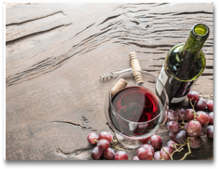 Plakat - Wine glass, wine bottle and grapes on wooden background. Wine tasting.