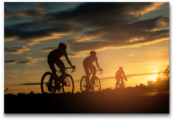 Plakat - The men ride  bikes at sunset with orange-blue sky background. Abstract Silhouette background concept.