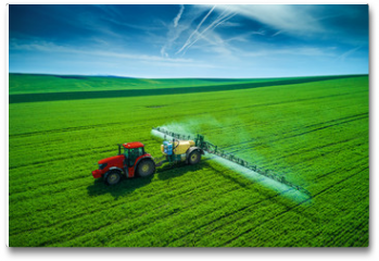 Plakat - Aerial view of farming tractor plowing and spraying on field