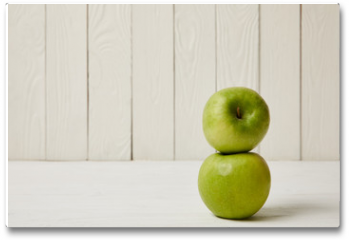 Plakat - Two raw fresh green apples on wooden background with copy space