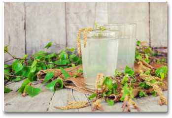 Plakat - birch sap in a glass. Selective focus.