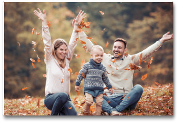 Plakat - Happy family having fun in autumn forest