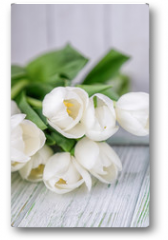 Plakat - Beautiful white tulips on a light wooden background. Free space