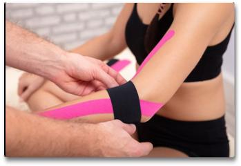 Plakat - Man Applying Black Physio Tape On Woman's Hand