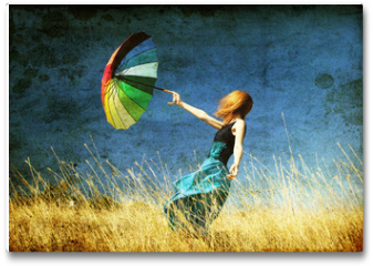 Plakat - Redhead girl with umbrella at windy grass meadow.