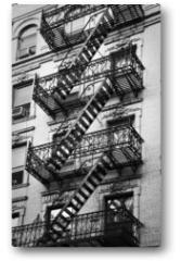 Plakat - Façade avec escalier de secours noir et blanc - New-York