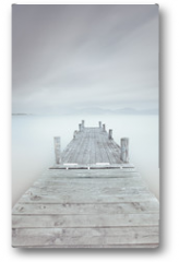Plakat - Wooden pier on lake in a cloudy and foggy mood.