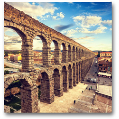 Plakat - The famous ancient aqueduct in Segovia, Castilla y Leon, Spain