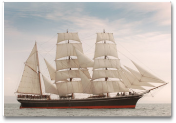 Plakat - Vintage windjammer style ship with full sails on the open sea
