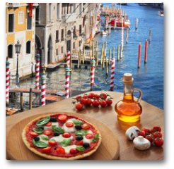 Plakat - Classic Italian pizza in Venice against canal, Italy