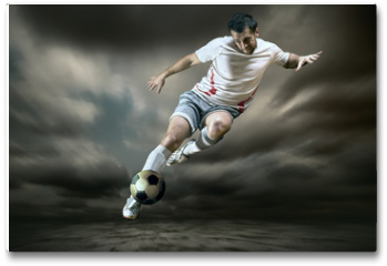 Plakat - Football player with ball on field of stadium