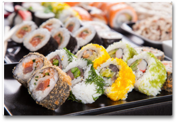 Plakat - Delicious sushi pieces served on black stone