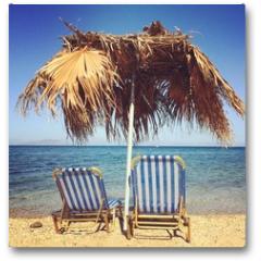 Plakat - Sunbeds with umbrella on the beach