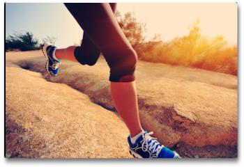 Plakat - woman runner athlete running at mountain trail