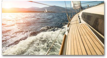 Plakat - Yacht sailing towards the sunset. Sailing. Luxury yachts.