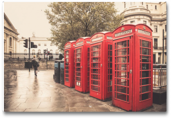 Plakat - Vintage style  red telephone booths on rainy street in London
