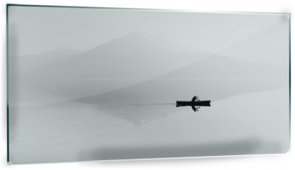 Panel szklany do kuchni - Fog over the lake. Silhouette of mountains in the background. The man floats in a boat with a paddle. Black and white