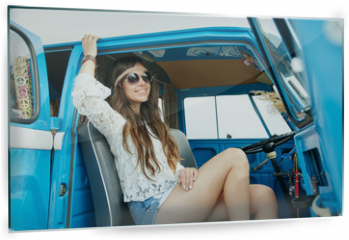 Panel szklany do kuchni - smiling young hippie woman in minivan car